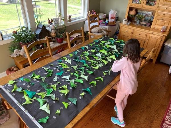 North Elementary Student works on origami butterflies