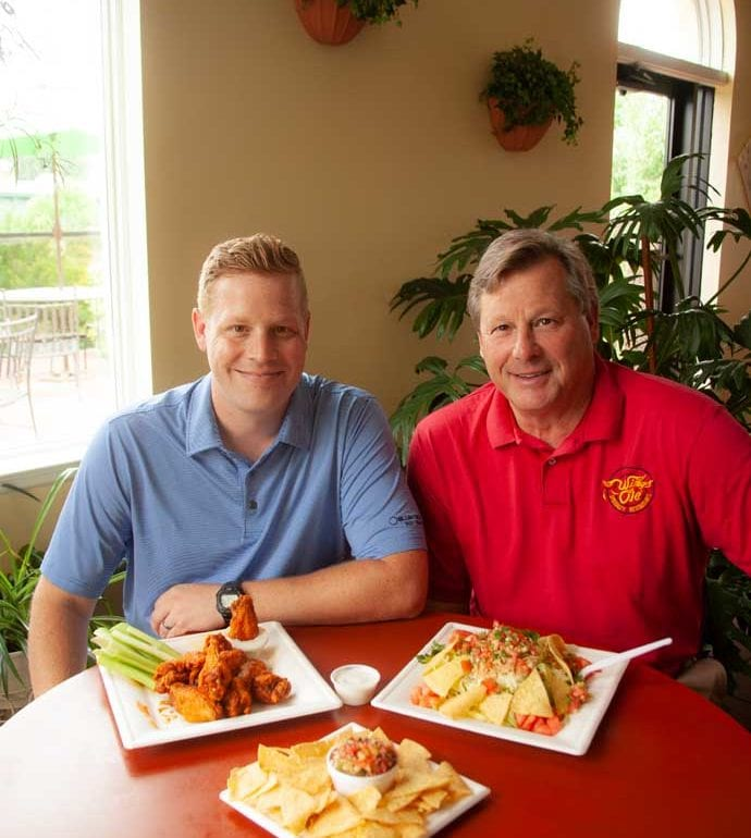 Father and son business owners of Wings Ole in Morgantown, West Virginia