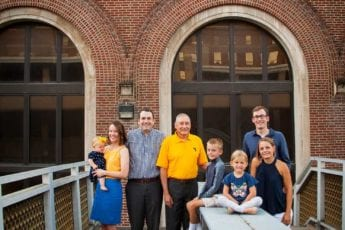 Family stands in front of Stansbury hall in Morgantown
