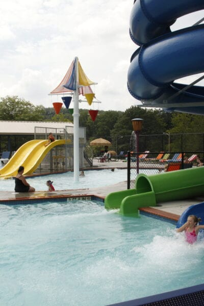 Family children playing summer waterpark fun activity summer