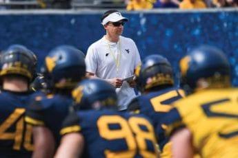 WVU football coach Neal Brown and his team